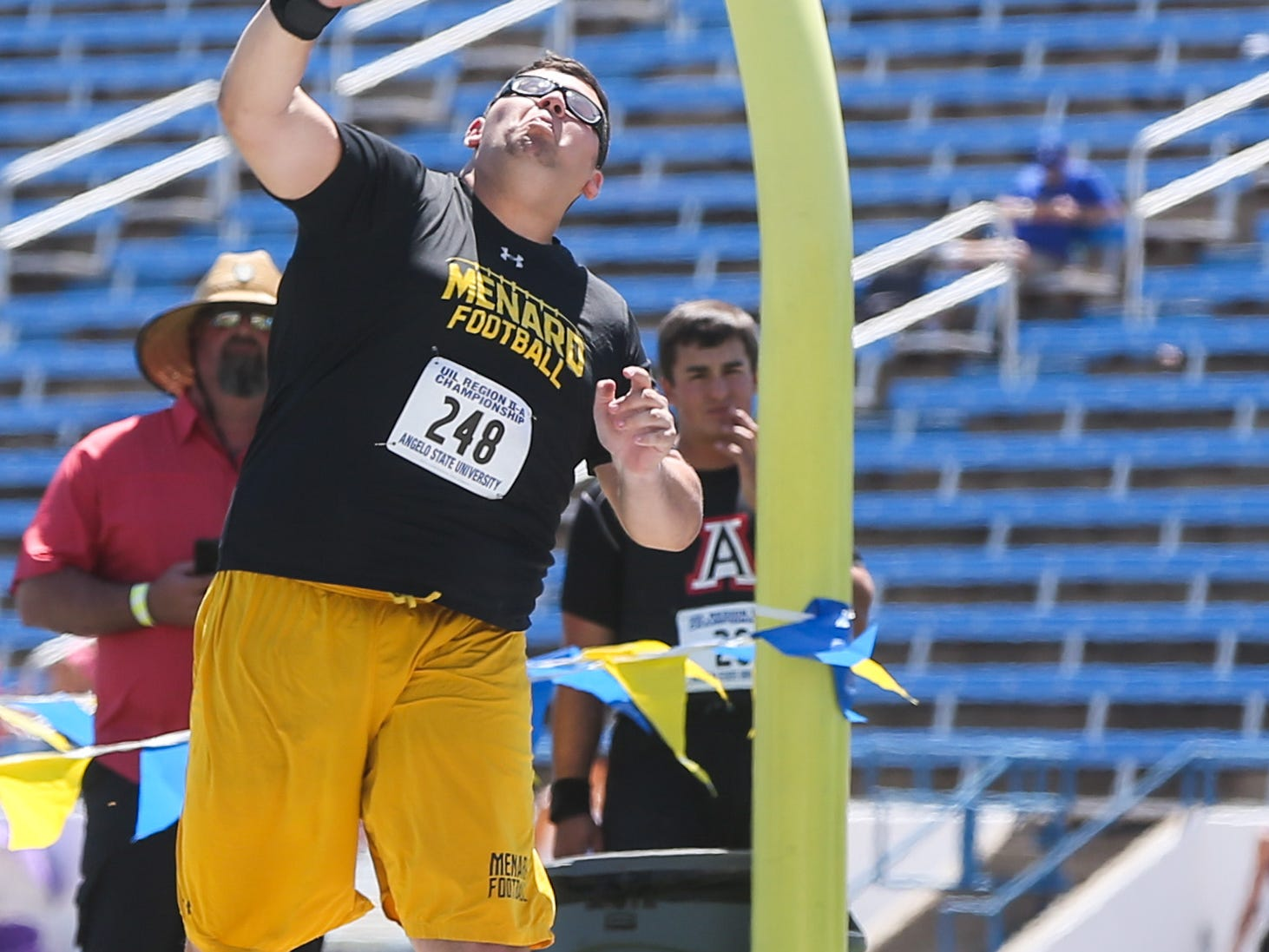 Menard's Mason Stanley throws a shot put during the Region II-1A championships Friday, April 26, 2019, at Angelo State University.