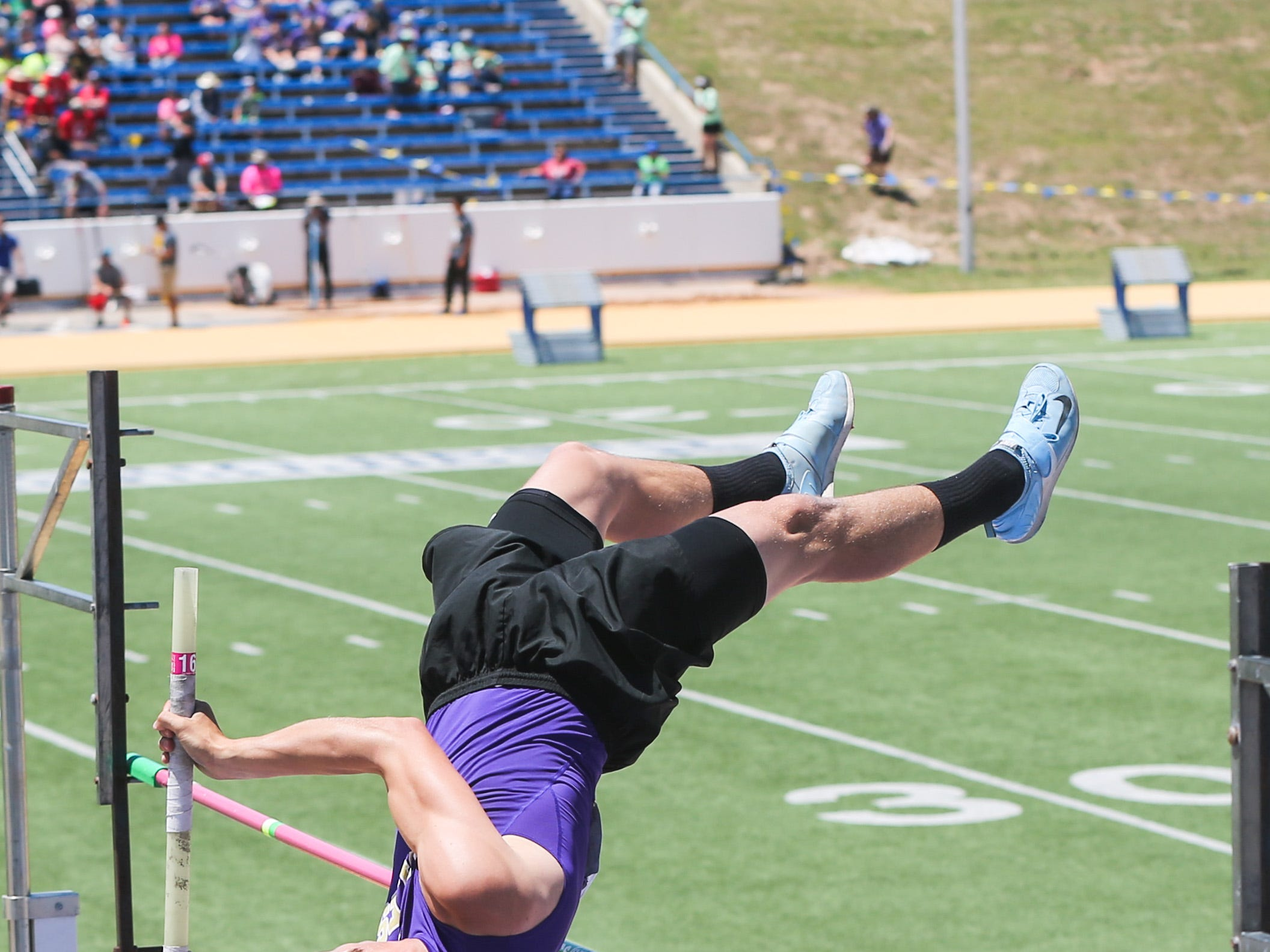 Sterling City's Quinton McMullan competes in the pole vault during the Region II-1A championships Friday, April 26, 2019, at Angelo State University.