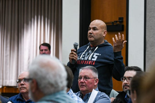 """Snow Hill farmer Mohammed Iqbal speaks at a meeting to discuss the poultry air quality monitoring plan at the University of Maryland Eastern Shore on Thursday, April 25, 2019. He addressed activists concerned over poultry farm emissions saying, """"if it's not in your backyard, it will be in someone elses."""""""