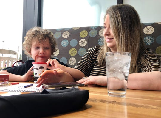 """""""We come here pretty often, and we're pretty bummed actually,"""" Beth Christensen said about her and her son Oliver's near weekly Hy-Vee Market Grill ritual. Here, Oliver enjoys his favorite drink (chocolate milk) at the Market Grill location on Minnesota Avenue while talking to his mother about his favorite Avengers characters."""