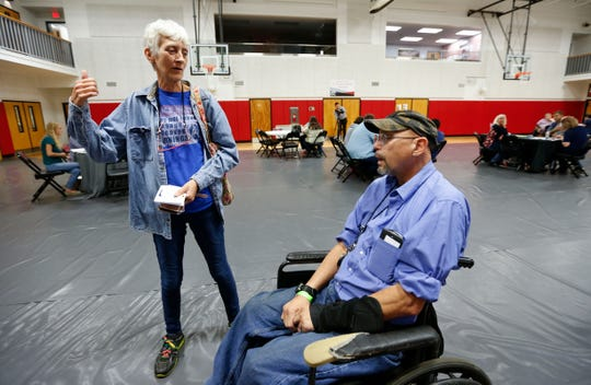 Neighbors Chuck McClancy and Sheena Tarver talk during an event for 417 Rentals tenants to get help at the Springfield Dream Center on Friday, April 26, 2019.