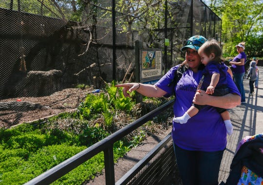 Cassie Dancause holds her granddaughter Hadlee Dancause as they walk through the Dickerson Park Zoo to celebrate what would have been her daughter Cheyenne Dancause's 21st birthday on Friday, April 26, 2019. Police say Cheyenne Dancause was shot to death Tuesday, Jan. 15, 2019 by her boyfriend, Chase Collins.