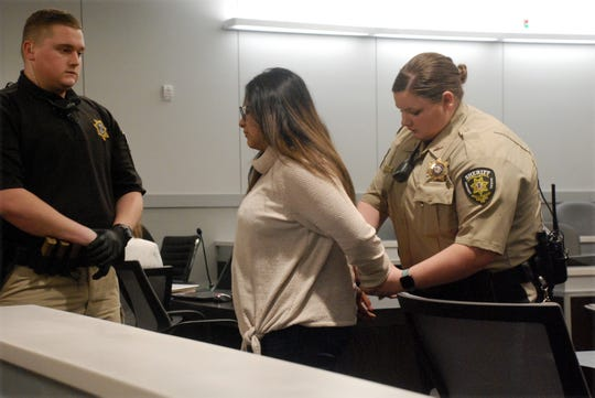 Alexandra Gonzalez is taken into custody Thursday at the Christian County courthouse.