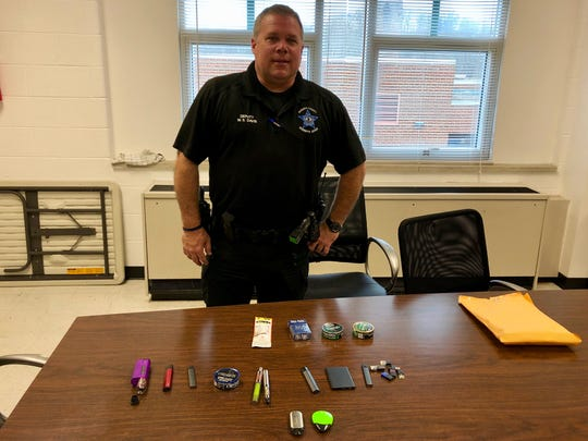 Deputy Steve Davis, Fort Defiance High School's resource officer, keeps an envelope of tobacco products confiscated at the school.