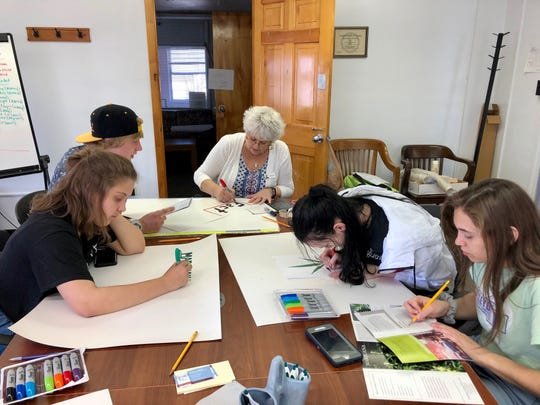 Greater Augusta Prevention Partners Coalition student group members Keaton Dinkle, Bryce Stickley, Kara Flavin and Lexi Hale make anti-marijuana legalization posters with Nancy Tyree at the Nelson Street Teen Center on April 4, 2019.