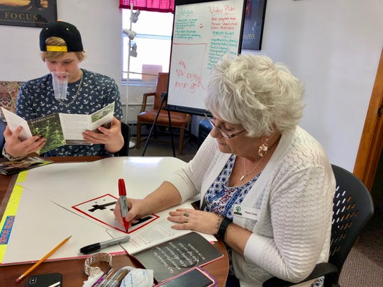 Greater Augusta Prevention Partners Coalition student group member Bryce Stickley makes anti-marijuana legalization posters with Nancy Tyree at the Nelson Street Teen Center on April 4, 2019.