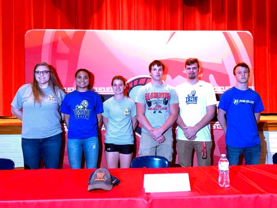 Six Riverheads athletes were recognized for their college choices Friday afternoon in the school auditorium. From left, Olivia Modlin, Jordan Jones, Kordelia Hunsberger, Blake Smith, Forrest Shuey, and G.W. Shultz.