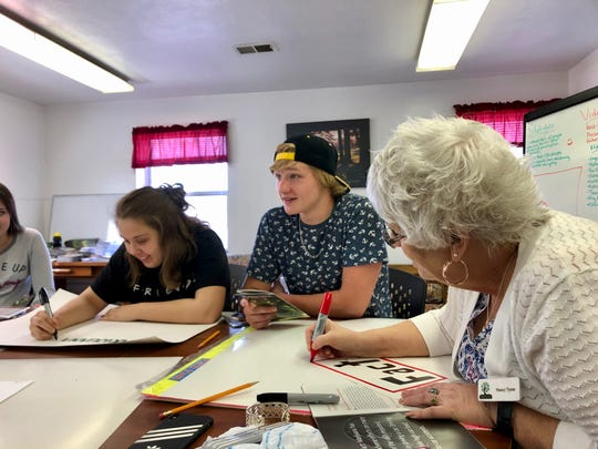 Greater Augusta Prevention Partners Coalition student group members Keaton Dinkle and Bryce Stickley make anti-marijuana legalization posters with Nancy Tyree at the Nelson Street Teen Center on April 4, 2019.