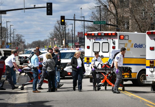 Emergency workers transport two men to ambulances on the 900 block of West St. Germain Street Friday, April 26, in downtown St. Cloud.