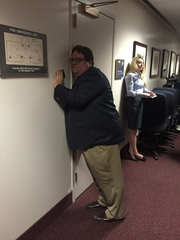 Capitol reporter Gary Fineout tries to hear what Republican House members were saying in a closed-door caucus during the 2015 legislative session.