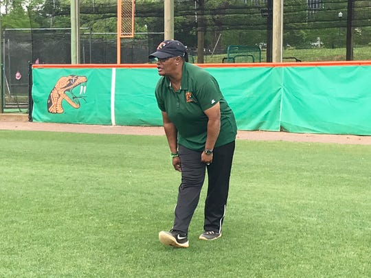 FAMU softball head coach Veronica Wiggins watches as the team performs drills in the outfield.