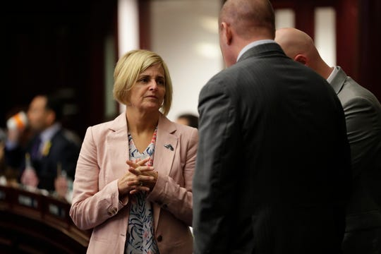 Rep. Loranne Ausley talks with colleagues while the House of Representatives is in session Thursday, April 25, 2019.