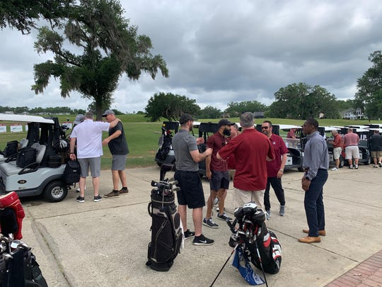 Florida State fans wait to get started golfing during Willie Taggart's spring booster tour stop at the Southwood Golf Club.