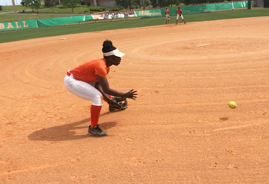 FAMU third baseman Shontell Cliatt digs out a grounder in practice.