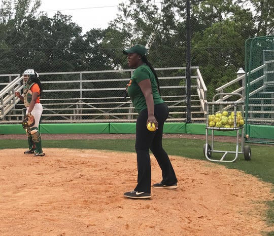 FAMU assistant softball coach Constance Orr hits grounders to all sides of the infield during practice.