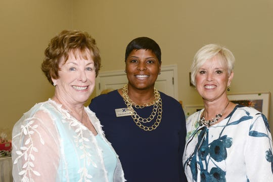Yolanda Sheppard with Celebrity Cruises, center, with Blue Ribbon Luncheon & Fashion Show Co-Chairs Sue Sharpe, left, and Diane Wilhelm.