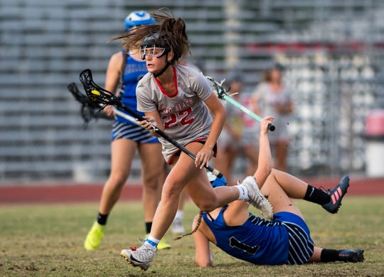 Vero Beach's Anna Sypniewski bowls over Sebastian River's Haley Knudsen, but is called on charging, during the first half of the high school girls lacrosse regional quarterfinal game Thursday, April 25, 2019, at Vero Beach High School. The reprieve for Sebastian was short-lived, as Vero scored their tenth goal within the following minute.