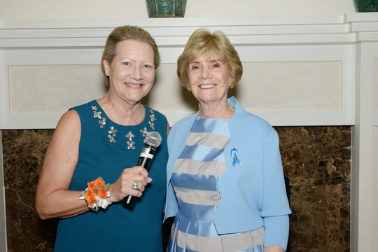 Master of Ceremonies Karen Loeffler, left, and Keynote Speaker Suzanne Bertman at the 20th Anniversary Blue Ribbon Luncheon & Fashion Show at Oak Harbor Club in Vero Beach.