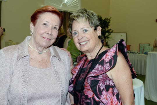 Hibiscus Guild members Helen Robertson, left, and Roni Fuster at the 20th Anniversary Blue Ribbon Luncheon & Fashion Show at Oak Harbor Club in Vero Beach.