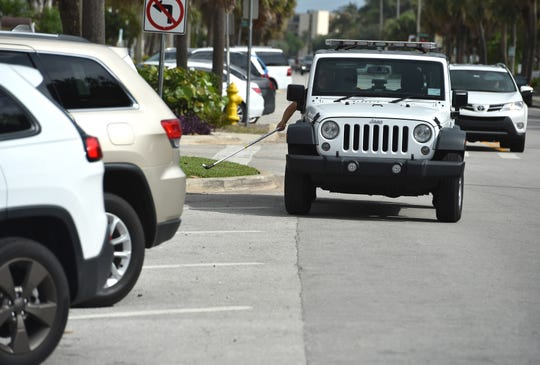 """John Makolin, a Parking Enforcement Officer, a non-sworn position with the City of Vero Beach, regulates the parking zones along downtown and beachside parking on Wednesday, March 31, 2017, in Vero Beach. """"During the season there are more people than there are parking spaces, so I keep them moving, fair shot for everybody to get in to a spot and enjoy the community,"""""""