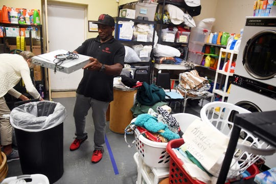 """My day consists of opening the building, greeting people at the front desk and handing out meal tickets to those that want to get lunch,"" said Eric Smith, now a full-time employee at The Source in Vero Beach. Smith, a former NFL player, found refuge at the Christian ministry that helped him get off the streets after his football career ended."