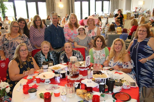 Friends gather for a photo at the Mustard Seed MinistriesTea and Fashion Show, from left, front row, Barb Hyne, Sheri Pinsker, Lisa Jones, Marlene Hood, Janie Latrimore and Catherine Chalmers; back row, Kim Martinez, Erin Hyne, Marlene Truppner, William Chilson, Maureen and Amanda Baldwin and Beth Monreal.