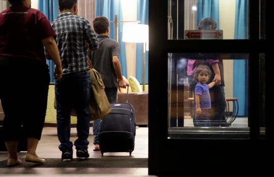 In this Monday, July 23, 2018, file photo, immigrants seeking asylum who were recently reunited arrive at a hotel, in San Antonio. A federal judge says he will give the Trump administration six months to identify children who were separated from their families at the U.S.-Mexico border early in the president's term. U.S. District Judge Dana Sabraw said Thursday, April 25, 2019, in San Diego that it was important to set a deadline for finding potentially thousands of children who were separated between July 1, 2017, and June 25, 2018.