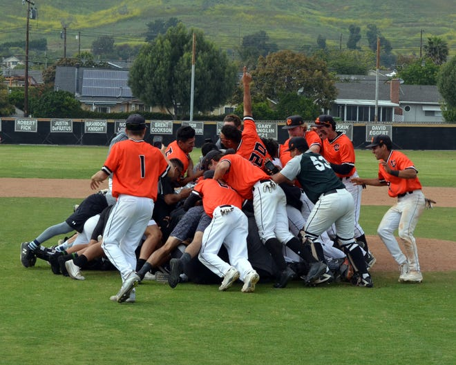 The Ventura College baseball celebrates Thursday's 3-1 win over Hancock, which clinched the program's first WSC North championship since 2006.