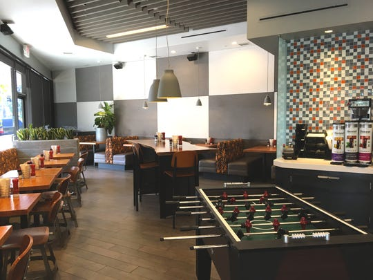 A foosball table is a new addition to the dining room at Fun Burger, which opened this month at what used to be Hook Burger in Simi Valley.