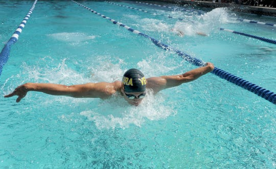 Ventura High's Jason Hepfer swims to first place in the boys 100 butterfly at the Pacific View League Swimming Championships at Buena High School Pool.