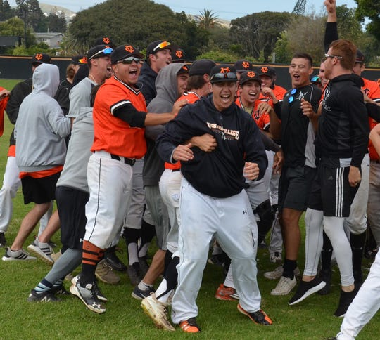 Ventura College baseball head coach Jimmy Walker (middle) celebrates the Pirates' first WSC North title since 2006.