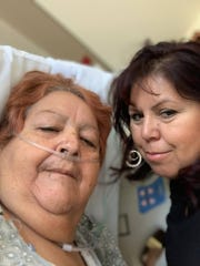 Marie Hamilton, right, visits her mother, Armida Castro, in the hospital.