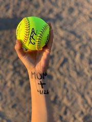 "Before every game, Mission Oak High School softball player, Lauren Reynoso, pays tribute to her late mother, Elisabeth, by writing ""mom"" on her left forearm. Elisabeth died in April 2016."