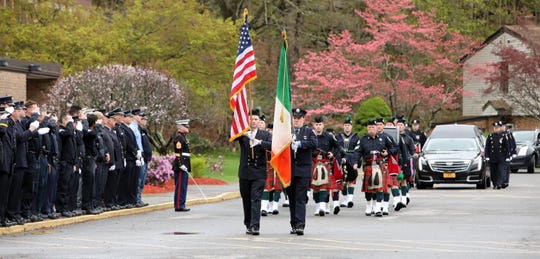 The funeral procession of World War II veteran Bob Graham arrives at St. Elizabeth Ann Seton Church in Shrub Oak April 26, 2019. With no close relatives, Beth Regan, 27, who befriended Graham while volunteering at the nursing home he lived, got the word out to have his funeral well attended. Several hundred, including veterans, police officers, firefighters, attended the military honors funeral.