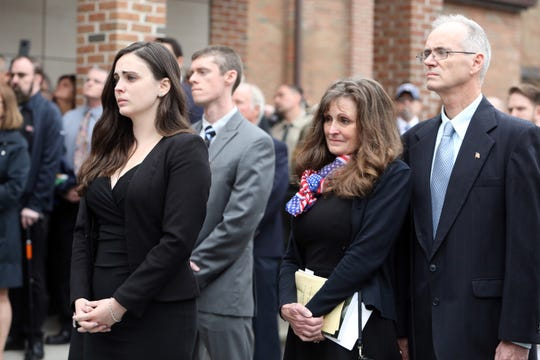 Beth Regan, left, with her parents Jim and Sue Regan watch as the ceremonial flag is folded after the funeral of World War II veteran Bob Graham at St. Elizabeth Ann Seton Church in Shrub Oak April 26, 2019. With no close relatives, Beth Regan, 27, who befriended Graham while volunteering at the nursing home he lived, got the word out to have his funeral well attended. Several hundred people, including veterans, police officers, firefighters, attended the military honors funeral.