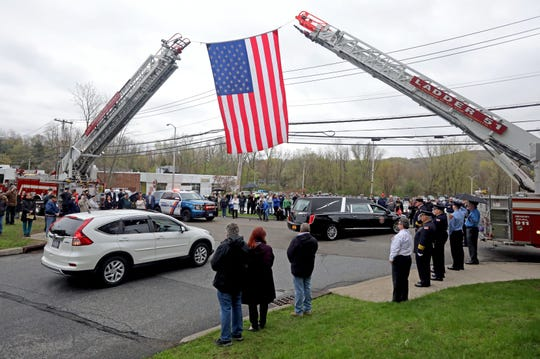 The casket of World War II veteran Bob Graham leaves St. Elizabeth Ann Seton Church in Shrub Oak April 26, 2019. With no close relatives, Beth Regan, 27, who befriended Graham while volunteering at the nursing home he lived, got the word out to have his funeral well attended.