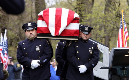 Members of the New York Police Department carry the casket of World War II veteran Bob Graham for his funeral at St. Elizabeth Ann Seton Church in Shrub Oak April 26, 2019. With no close relatives, Beth Regan, 27, who befriended Graham while volunteering at the nursing home he lived, got the word out to have his funeral well attended.