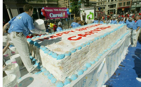 NEW YORK, UNITED STATES:  Workers put the finishing touches on the World's Largest Ice Cream Cake by Carvel at Union Square Park in New York City 25 May, 2004. A representative of Guinness World Records was on hand to watch workers make the cake which was built to celebrate the 70 year history of the company.    AFP PHOTO/Timothy A. CLARY  (Photo credit should read TIMOTHY A. CLARY/AFP/Getty Images)