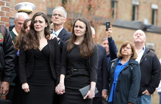 Beth Regan, left, her sister Sarah Regan and their parents Jim and Sue Regan watch as the casket of World War II veteran Bob Graham arrives at St. Elizabeth Ann Seton Church in Shrub Oak April 26, 2019. With no close relatives, Beth Regan, 27, who befriended Graham while volunteering at the nursing home he lived, got the word out to have his funeral well attended. Several hundred people, including veterans, police officers, firefighters, attended the military honors funeral.