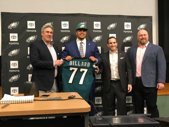 Eagles' first-round draft pick, Andre Dillard, shows off his jersey as he's flanked by head coach Doug Pederson, left, executive VP Howie Roseman and VP of player personnel Joe Douglas.