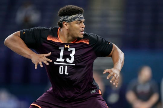 FILE - In this March 1, 2019, file photo, Washington State offensive lineman Andre Dillard runs a drill at the NFL football scouting combine in Indianapolis. Dillard is a possible pick in the 2019 NFL Draft. (AP Photo/Michael Conroy, File)