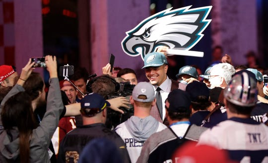 Washington State tackle Andre Dillard walks near fans after the Philadelphia Eagles selected him in the first round at the NFL football draft, Thursday, April 25, 2019, in Nashville, Tenn. (AP Photo/Mark Humphrey)