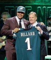 Washington State tackle Andre Dillard poses with NFL Commissioner Roger Goodell after the Philadelphia Eagles selected Dillard in the first round at the NFL football draft, Thursday, April 25, 2019, in Nashville, Tenn. (AP Photo/Steve Helber)