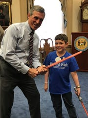 "Gov. John Carney (left) proclaimed April 29 as World Wish Day in Delaware. Jack Frazier (right) received ""Jedi training""  through the Make a Wish Foundation."