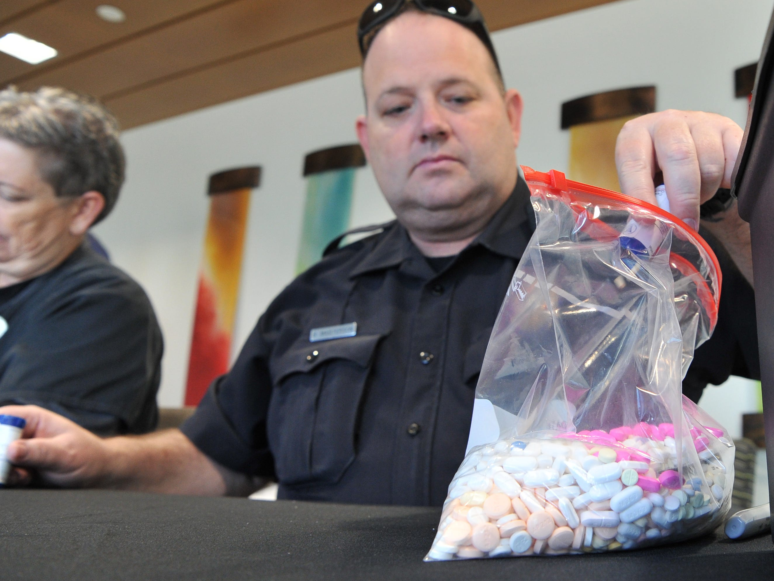 Wichita Fall police officer, Brian Masterson collects prescription and over-the-counter medication during United Regional hospital's and the Wichita Falls Police department's drug take-back event held at the south end of the Emergency Room, Friday afternoon.