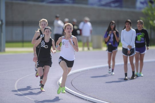 Holliday freshman Hannah Spears (16) leads the 3,200-meter run at the Region I-3A Meet at Abilene Christian University. Spears won the race, qualifying for state.