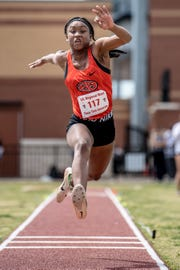 Burkburnett's Tania Lee won a gold medal Friday in the Region I-4A triple jump with a person-best 37-9.