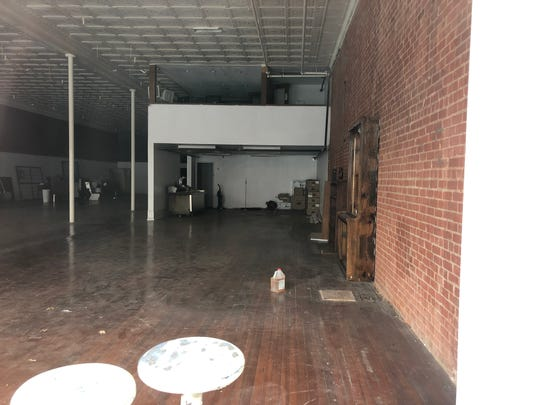 Interior renovations at 922 Indiana include recovery of original ceiling tiles, revealing original brick walls and restoring the hardwood floor. The space is being renovated for use as a retail store. Funding for the project was approved by 4B for a fire suppression system.