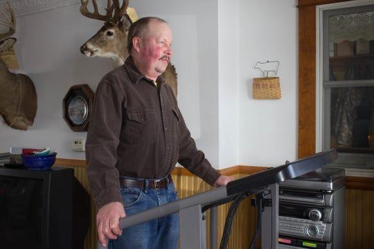 Jackson County Farm Bureau president Steve Kling walks on the treadmill to regain his strength after his lung transplant surgery.