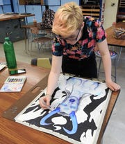 Jaidyn Brink works on an art piece at Coshocton High School. The freshman recently placed first and second for 2-D composition in the annual Teen-Age Talent show for local high school students at the Johnson-Humrickhouse Museum.